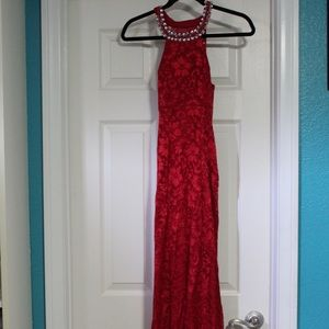 Red, lengthy prom dress.